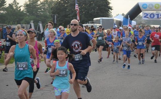 Runners take off from the starting line during the 5K at the Battle Creek Half Marathon and 5K on Saturday.