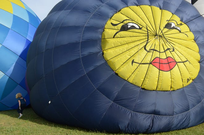 Pilot Janet Lutkus of Medina, Ohio, always has a pretty face at the top of her balloon.