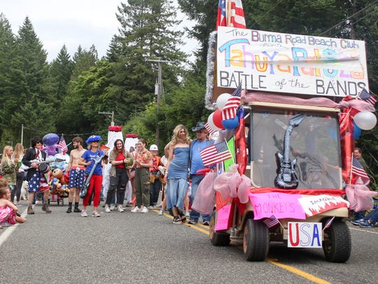 The Burma Road Beach Club consists of a group of cabin owners  that join together each year for a themed walk through the Tahuya Days parade. This years theme was bands.