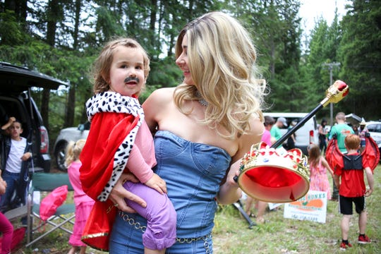 Val Sowell dressed as Britney Spears holds her daughter Willa ahead of the Tahuya Days parade.