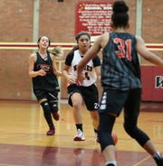South Kitsap's Areeza Amian dribbles the ball up the floor against Central Kitsap during a summer league game July 5, 2019.