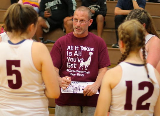 South Kitsap girls basketball coach CJ Scott talks to his players during a summer league game against Central Kitsap on July 5, 2019.