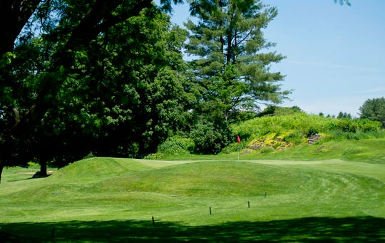 The green at the par-4 eighth hole is tucked tight to a hill on the right, with a bunker to the left at Rutland Country Club, site of the 2019 Vermont Amateur golf championship.