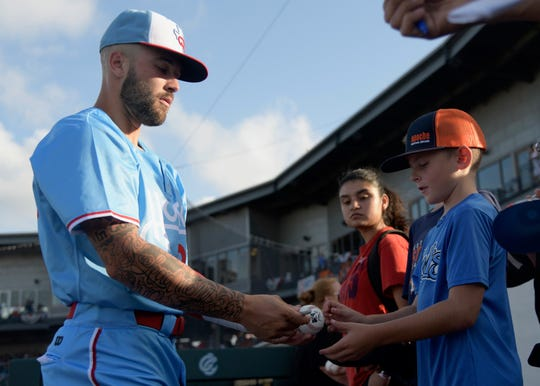 Hooks infielder JJ Matijevic signs autographs prior a game on Friday, July 6, 2019 at Whataburger Field in Corpus Christi, Texas.