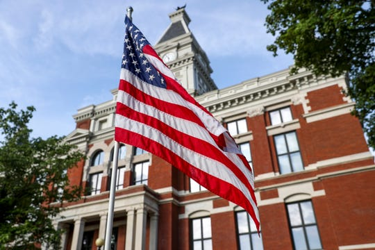 An American flag planted for July 4th celebrations wafts in the air outside at Historic Montgomery County Courthouse in Clarksville, Tenn., on Friday, July 5, 2019.