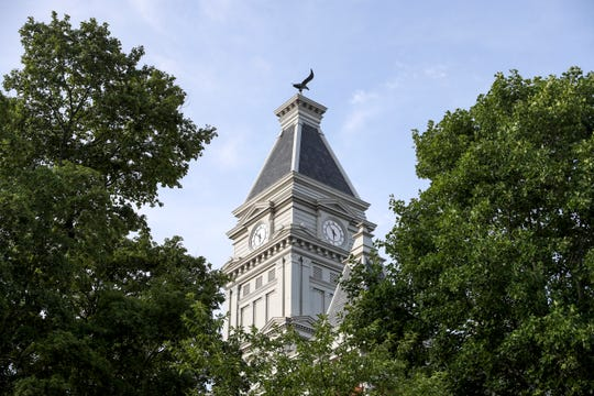 The tip of the clocktower can be seen through trees at Historic Montgomery County Courthouse in Clarksville, Tenn., on Friday, July 5, 2019.