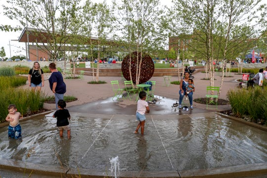 Children play in a small water spout and pool area at the Downtown Commons in Clarksville, Tenn., on Friday, July 5, 2019.
