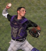 Norwalk senior catcher Sebastian Hutson throws to first after fielding a bunt. Indianola beat Norwalk 7-1 in the first game of a July 5 doubleheader in Indianola.