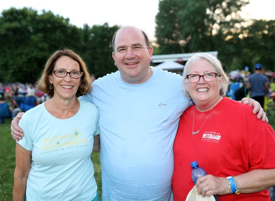 Des Moines City Council members Connie Boesen, Chris Coleman, and Linda Westergaard attend Rendezvous on Riverview featuring a free concert with Stark Raving Madge and fireworks at the Union Labor Park in Des Moines on Friday, July 5, 2019.