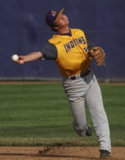 Indianola freshman shortstop Kael Kolarik throws to first base. Indianola beat Norwalk 7-1 in the first game of a July 5 doubleheader in Indianola.