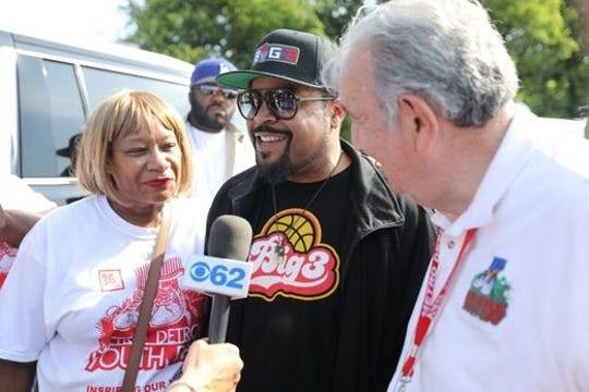 Ed Deeb , founder of  Metro Detroit Youth Day, with entertainer Ice Cube, who who was among luminaries joining thousands of children who attended the annual event on July 11, 2018 at Belle Isle.