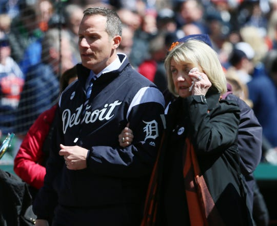 Christopher Ilitch and his mother Marian Ilitch make an emotional exit after a ceremony in remembrance of Mike Ilitch, before the Detroit Tigers face the Boston Red Sox on Opening Day, April 7, 2017 at Comerica Park in Detroit.