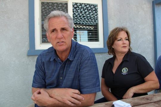 House Minority Leader Kevin McCarthy, left, R-Calif., reflects on his quick visit to Ridgecrest, Calif., as California State Senator Shannon Grove, R-Bakersfield, looks on, just before taking off from the Inyokern Airport, in Inyokern, Calif.