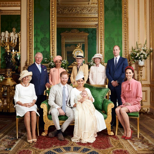 Britain's Prince Harry, front row, second left, and Meghan, the Duchess of Sussex with their son, Archie. Camilla, the Duchess of Cornwall sits at left. Back row from left, Prince Charles, Doria Ragland, Lady Jane Fellowes, Lady Sarah McCorquodale, Prince William and Kate, the Duchess of Cambridge, in the Green Drawing Room at Windsor Castle, Windsor, England.