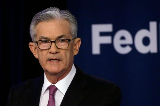 In this file photo dated Tuesday, June 4, 2019, Federal Reserve Chairman Jerome Powell speaks at a conference involving its review of its interest-rate policy strategy and communications, in Chicago, USA.