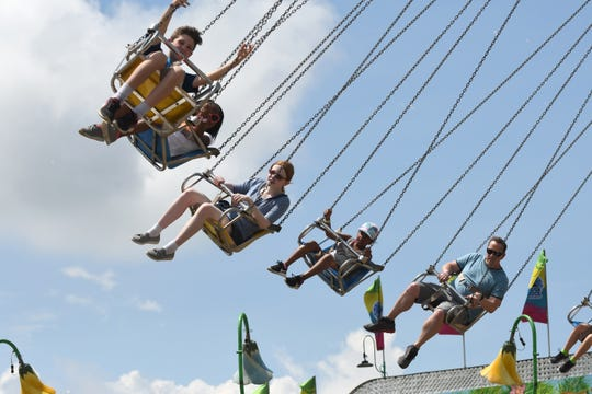 Adults and children ride the Yo-Yo at the Oakland County Fair.