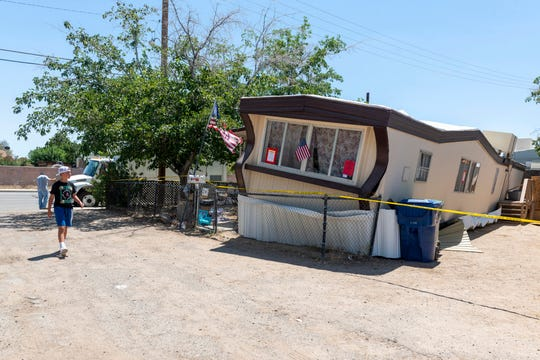 A child walks by one of the mobile homes knocked off its foundation by an earthquake in Ridgecrest, Calif., on Friday July 5, 2019.
