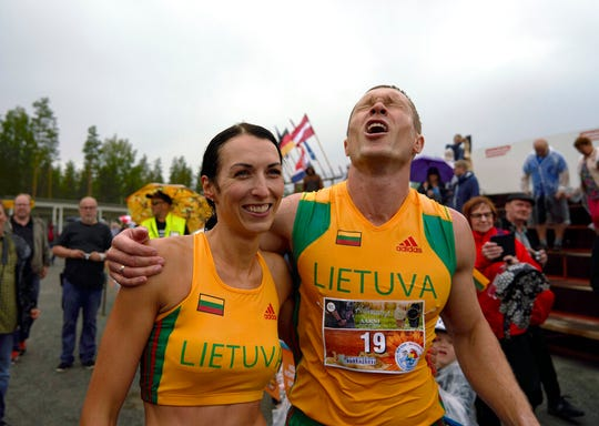 Lithuanian couple Vytautas Kirkliauskas, right, and Neringa Kirkliauskiene celebrate their victory in the 24th wife carrying world championships in Sonkajarvi, Finland, Saturday.