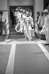 In this July 16, 1969 file photo, Apollo 11 commander Neil Armstrong gives a thumbs up signal as the three Apollo astronauts walk to the transfer van en route to the Saturn Five rocket ready to blast off for the moon, July 16, 1969, Cape Kennedy, Fla.