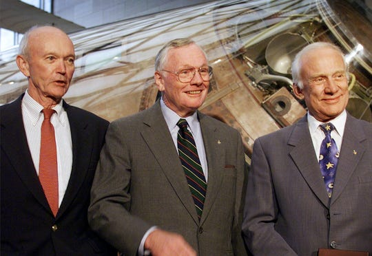 Apollo 11 astronauts Michael Collins, left, Neil Armstrong and Buzz Aldrin are awarded the Samuel P. Langley medal at a ceremony at the Smithsonian's Air and Space Museum in Washington, July 20, 1999.