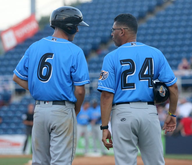 Ernie Clement of the Akron RubberDucks talks to manager Rouglas Odor at third base during a game against the Binghamton Rumble Ponies on July 5, 2019 at Binghamton's NYSEG Stadium.