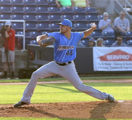 Canandaigua Academy graduate Adam Scott, shown pitching during a game last season for the Akron Rubber Ducks in Binghamton, is back in New York after spring training was suspended.