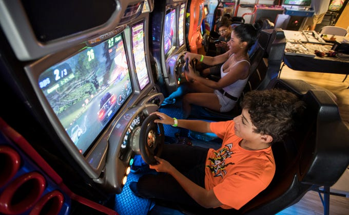 Cody Bradley, 13, of Cape Coral, and his mom Shey Bradley, play a race-car video game at The Retro Zone, a vintage 1980s-style video game arcade, opened June 4 at 2158 Colonial Blvd., next door to The Ranch nightclub, just east of the U.S. 41 overpass.The Retro Zone, a vintage 1980s-style video game arcade, opened June 4 at 2158 Colonial Blvd., next door to The Ranch nightclub, just east of the U.S. 41 overpass.