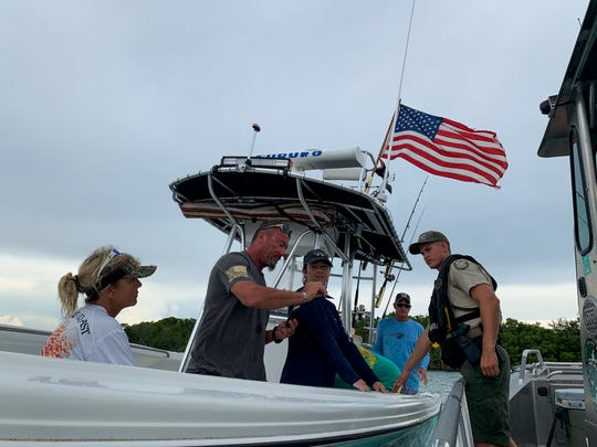 FWC law enforcement officer Adam Winton conducts a fishery inspection in Southwest Florida during the kick-off of the national Operation Dry Water campaign on July 5, 2019.