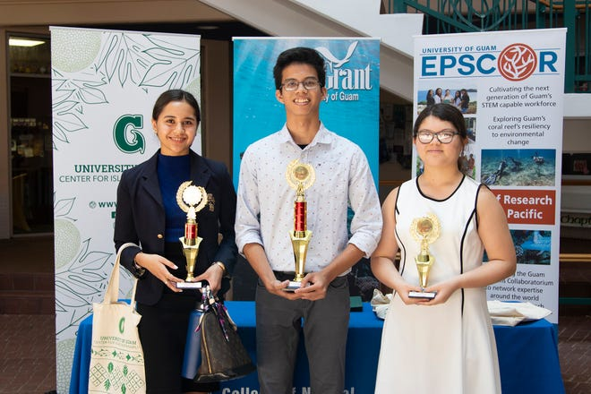 From left, National Science Foundation INCLUDES School Science Fair second-place winner Anica Camacho, first-place winner Jerome Ariola, and third -place winner Isabella Certeza.