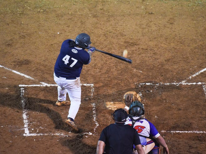 IT&E Rays catcher Vic Fernandez connects with the ball during his at-bat against the 76 Expos in their second game of the 2019 Guam Major League Championship Series at Paseo Stadium on July 5, 2019.