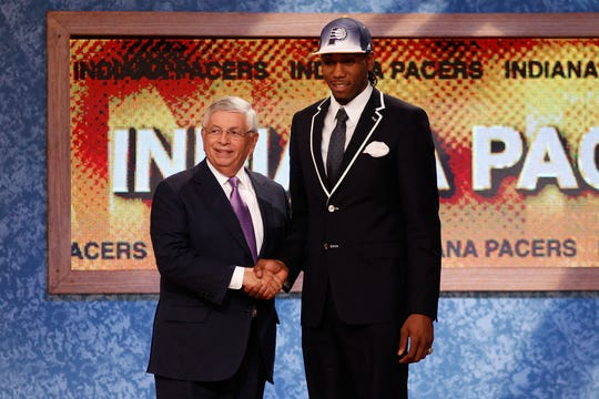 Kawhi Leonard greets NBA Commissioner David Stern after he was selected No. 15 by the Pacers during the 2011 NBA Draft. He was then traded to San Antonio for George Hill.