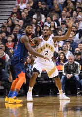 Mar 22, 2019; Toronto, Ontario, CAN; Toronto Raptors forward Kawhi Leonard (2) battles with Oklahoma City Thunder forward Paul George (13) during the first quarter at Scotiabank Arena. Mandatory Credit: Nick Turchiaro-USA TODAY Sports
