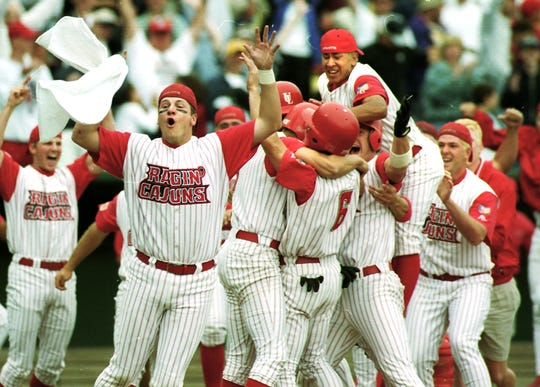The Ragin' Cajuns baseball team celebrates its victory over Clemson in the 2000 College World Series in Omaha, Neb.