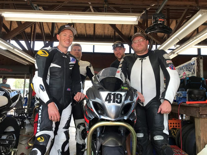 The 419 Racing Team of Jerry Reeves (front left) Eden Weston (back left), Jon Crawford (back right) and Jake Maas (front right) showed off on their home track over the weekend at the Honda AMA Vintage Motorcycles Days at Mid-Ohio Sports Car Course.