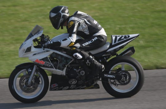419 Racing's Jerry Reeves zips around Mid-Ohio Sports Car Course during a practice round Saturday morning during the Honda AMA Vintage Motorcycle Days at Mid-Ohio.