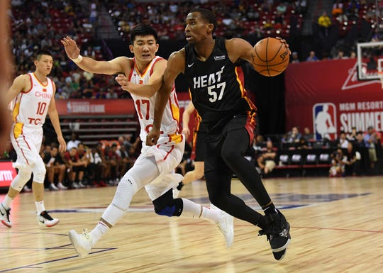 Miami Heat guard Jeremiah Martin (57) dribbles against Chinese National Team guard Minghui Sun (17) during an NBA Summer League game in Las Vegas on July 5, 2019.