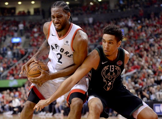 Kawhi Leonard (left) and Malcolm Brogdon will have new homes next season with Leonard joining the Clippers in free agency and the Bucks formalizing the deal sending of Brodgon to the Pacers.