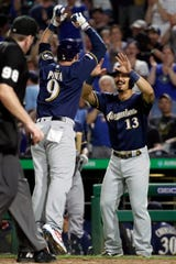 The Brewers' Manny Pina celebrates with Tyler Saladino after Pina's two-run homer on Friday.