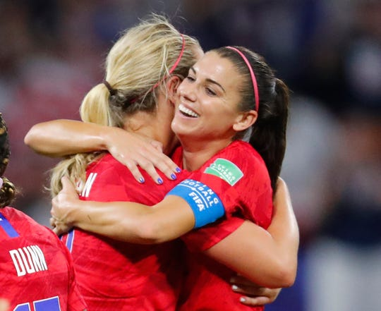 United States forward Alex Morgan (right) hugs midfielder Lindsey Horan (left) after defeating England during semi-final play in the FIFA Women's World Cup France 2019 soccer tournament at Stade de Lyon on Tuesday.