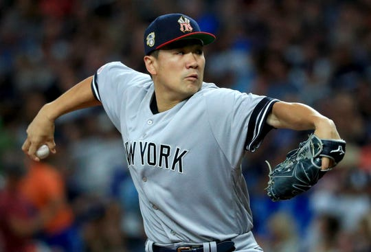 ST PETERSBURG, FLORIDA - JULY 05: Masahiro Tanaka #19 of the New York Yankees pitches during a game against the Tampa Bay Rays at Tropicana Field on July 05, 2019 in St Petersburg, Florida.
