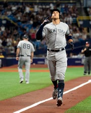 New York Yankees right fielder Aaron Judge (99) reacts after hitting a home run in the first inning against the Tampa Bay Rays at Tropicana Field.