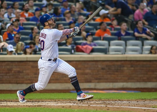 Jul 5, 2019; New York City, NY, USA; New York Mets first baseman Pete Alonzo (20) hits a solo home run in the fourth inning against the Philadelphia Phillies at Citi Field.