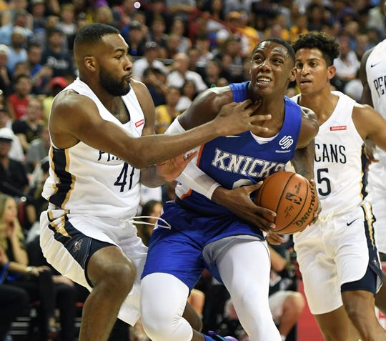 LAS VEGAS, NEVADA - JULY 05:  RJ Barrett #9 of the New York Knicks drives against Jevon Bess #41 of the New Orleans Pelicans during the 2019 NBA Summer League at the Thomas & Mack Center on July 5, 2019 in Las Vegas, Nevada. NOTE
