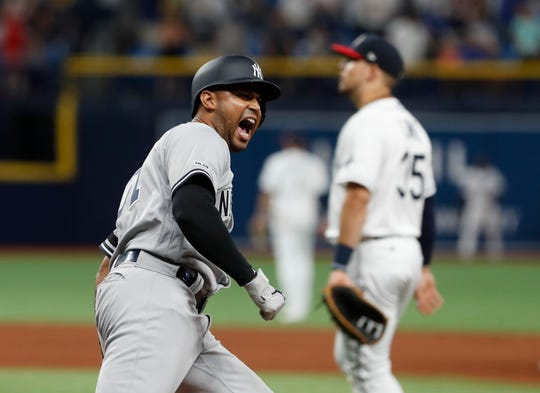 New York Yankees' Aaron Hicks reacts after hitting a home run to tie the game against the Tampa Bay Rays during the ninth inning of a game Saturday, July 6, 2019, in St. Petersburg, Fla.