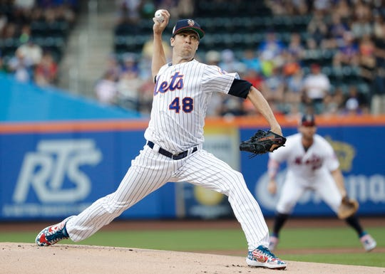 New York Mets' Jacob deGrom delivers a pitch during the first inning of the team's game against the Philadelphia Phillies on Friday, July 5, 2019, in New York.