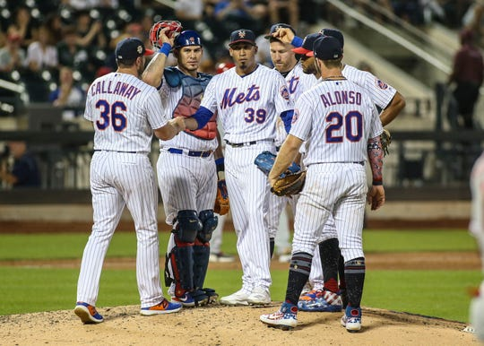 Jul 5, 2019; New York City, NY, USA; New York Mets manager Mickey Callaway (36) removes pitcher Edwin Diaz (39) from the game in the ninth inning against the Philadelphia Phillies at Citi Field.