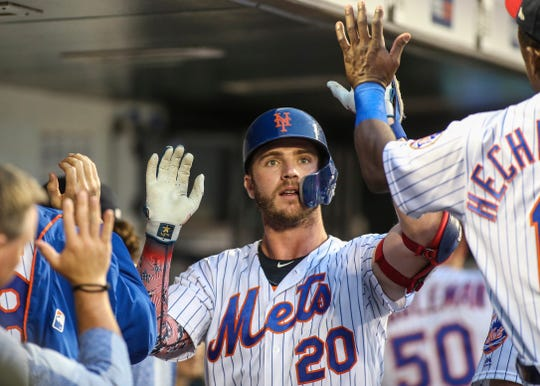 Jul 5, 2019; New York City, NY, USA; New York Mets first baseman Pete Alonzo (20) is greeted in the dugout after hitting a home run in the fourth inning against the Philadelphia Phillies at Citi Field.