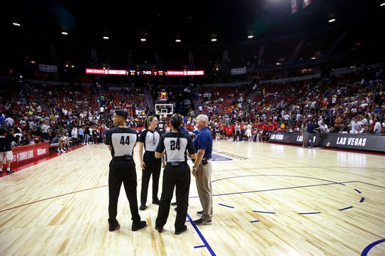 Officials confer after an NBA summer league basketball game between the New York Knicks and the New Orleans Pelicans was stopped following an earthquake Friday, July 5, 2019, in Las Vegas.