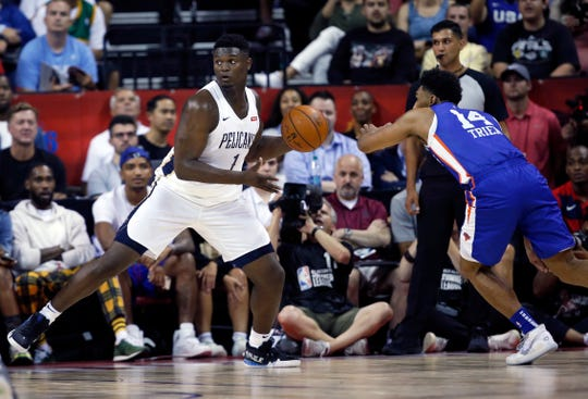 New Orleans Pelicans' Zion Williamson (1) looks to pass the ball during the team's NBA summer league basketball game against the New York Knicks on Friday, July 5, 2019, in Las Vegas. Knicks' Allonzo Trier is at right.