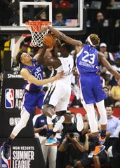 Jul 5, 2019; Las Vegas, NV, USA; New Orleans Pelicans forward Zion Williamson (1) is fouled as he drives to the basket by New York Knicks forward Kevin Knox (left) and center Mitchell Robinson during the first half of an NBA Summer League game at Thomas & Mack Center.